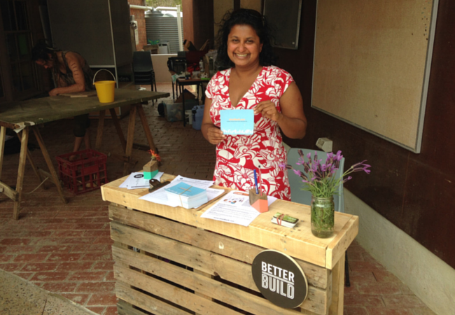 Our meet and greet volunteer from Streetbank, Chamali, behind the hand made workshop info desk.